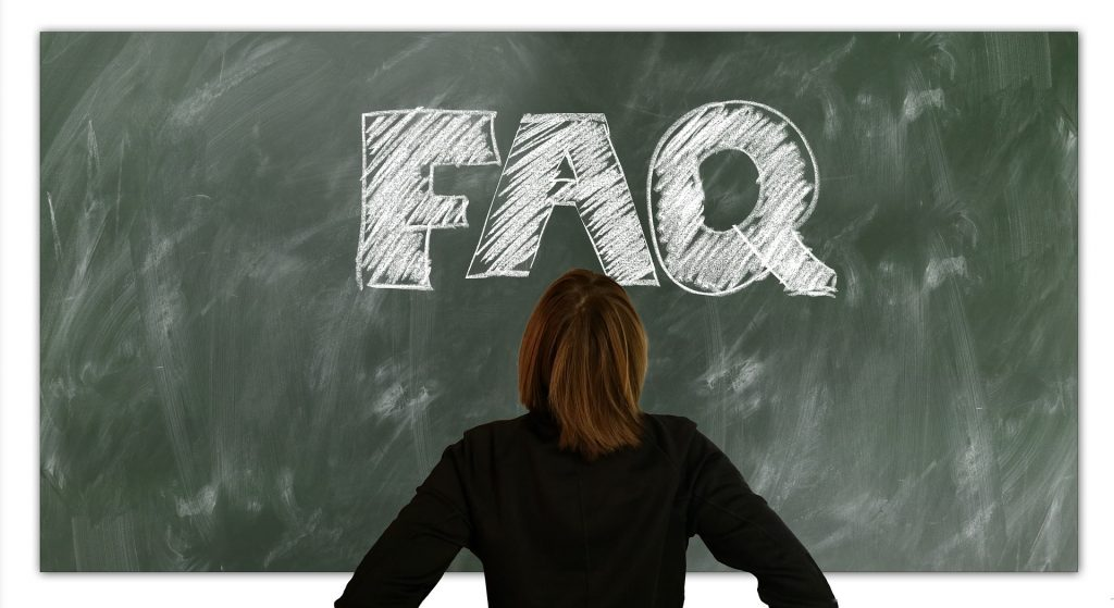 Image of woman staring at chalk board that says FAQ