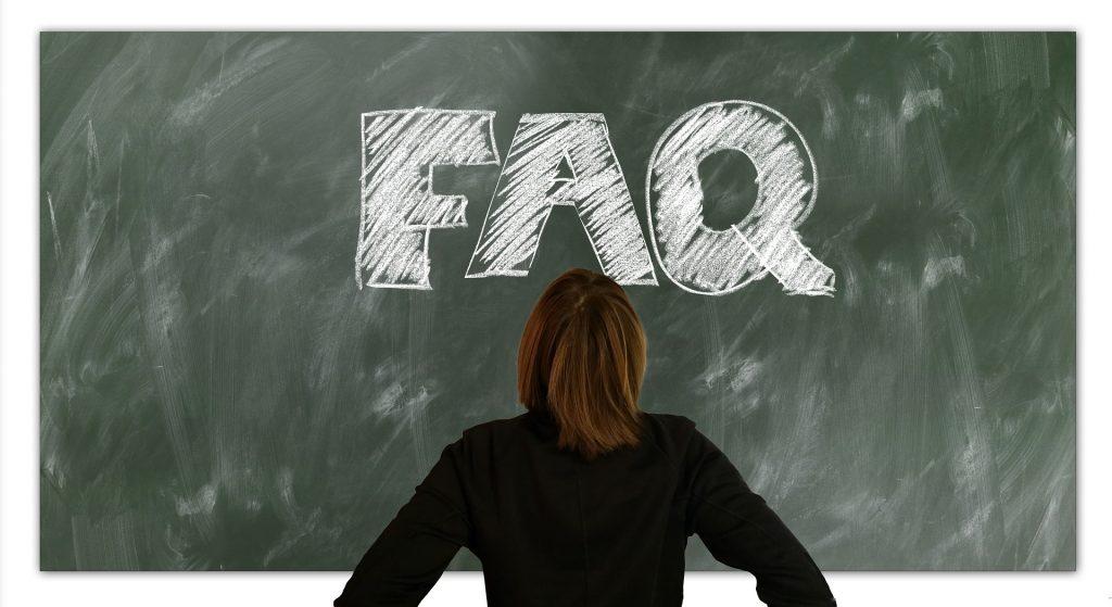Image of woman staring at chalk board that says FAQ